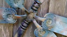 """Cindy McRee, from Bradenton, FL says, """"My son assembled another dragonfly for me to paint! love the """"wings"""" on this one. The body is a table leg, the head is a section of another table leg & the wings are ceiling fan blades. The eyes & antenna are whatever we find – bolts, wires, etc. You have to modify the screw plates sometimes to fit onto the body and then get creative with spray paint!"""""""