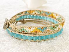 Make a splash of color with bright turquoise blue sea glass contrasting with turquoise greens, vanilla and a splash of starfish yellow! This fun and