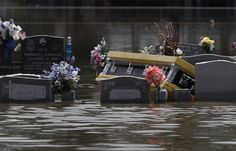 As if the site of floodwaters ripping through communities in southern Louisiana wasn't eerie enough, the high waters have begun lifting graves from their final resting places. The flood appears to have dislodged the above-ground grave coverings at many of the region's cemeteries, sending the enclosed caskets floating.