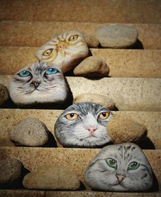 cat painted rocks would look good peeking out from plants and grasses