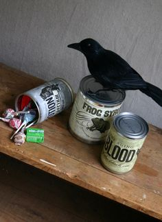 diy halloween decor.  open cans with safety can opener, clean, remove old label, attach new label, fill with treats and snap lid back in place.  to open favor can just pull up on lid from the rim