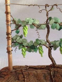Grapevine Sculpture  This Grapevine Sculpture is an original, MyTwistedArt design. This particular design & style of sculpture has never been done by anyone else.   Foliage: Aventurine & light green, re or purple seed beads Wire: brown Base: driftwood Size: 4 1/2 inches high by 5 inches wide   Sculptures  Elegantly handmade grapevine sculptures are skillfully, beaded by hand and weaved together to form a grapevine with unique character, with twisted roots that encircle and anchor the…