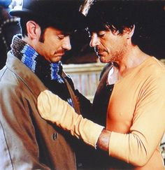"""A tender moment - Watson and Holmes (Jude Law and Robert Downey Jr.) in """"Sherlock Holmes: A Game of Shadows"""""""