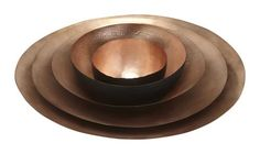 Set of 5 varying sizes of bowls hand formed from a single sheet of copper, finished with a matt wash with a black outside and lacquered finish.