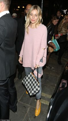Looking good: Sienna Miller seemed in great spirits as she greeted the well wishers ahead ...