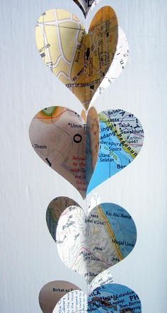 vertical heart garland.   This could be made with book pages, music sheet, scrapbook pages, kraft paper, gift wrap, maps, etc.