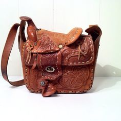 So old school. but I really want one of these Saddle Purses:)