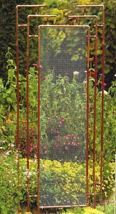 Trellis made out of copper pipe & wire mesh.Would be lovely in a small garden to break the line of vision and gives a diffuse view of the planting behind it, great as an outdoor room divider and would give structure in a winter border. Garden Crafts, Garden Projects, Garden Ideas, Outdoor Art, Outdoor Gardens, Outdoor Sheds, Metal Garden Trellis, Obelisk Trellis, Wire Trellis