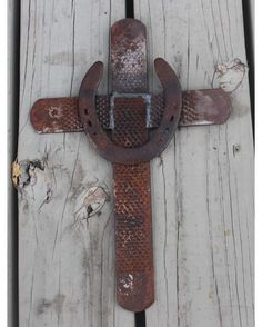 The Lord is my strength and my shield Psalm 28:7.  This horseshoe rasp cross brings a piece of rustic charm to any home whether nailed to the wall or sitting on a shelf. Made with authentic recycled horseshoe rasps from a local farrier, it weighs 3 pounds and measures 16.5 inches tall x 11 inches wide.