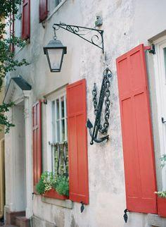 "Historic Home in Charleston, SC I love the ""shutter dogs"" ...so unusual"