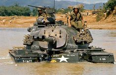 American Tank Fords a River - Members of the 5th Mechanical Division ford a river in a tank, Can Lo River, south of Con Thien, Vietnam. 1968 - The M48A3 battle tank was the heaviest tank used in vietnam. It had a crew of four, was armed with a 90mm cannon with a coaxial .30-inch machine gun and an externally mounted .50-inch machine gun.