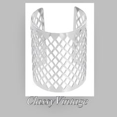 Silver tone Diamond pattern cuff bracelet Large cuff bracelet - cuff style with diamond pattern cutouts. Boutique Jewelry Bracelets
