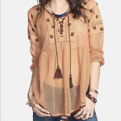 """Free People ROSES ARE RED PEASANT TOP - Small NWT Free People ROSES ARE RED PEASANT TOP A delicately embroidered lace-up yoke and lush blouson sleeves romance a gauzy cotton tunic with medieval-inspired charm DETAILS: •      Retail $108 •      Style #F357u902 •      Color: Sunset Orange •      Size: Small •      26 ½""""L ; Bust: 19"""" •      68% cotton, 32% nylon; Trim: 100% cotton •      Sheer; base layer recommended •      Machine wash cold, lay flat to dry •      Import Brand New with Tags –…"""