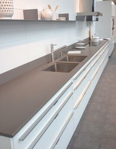 FORSTER - Swiss Steel kitchen with  Silstone countertop in Unsui