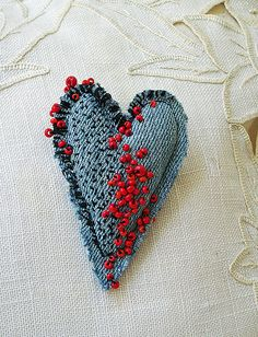 heart pin red beads I'm having a great time making little heart shaped pins from bits of worn denim, stitching, and beads. Jean Crafts, Denim Crafts, Fabric Brooch, Felt Brooch, Brooch Pin, Textile Jewelry, Fabric Jewelry, Jewellery, Textile Art