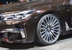 Get the small image for free or buy high resolution pictire of BMW 7er. Wheel, Headlights, Long Wheelbase.