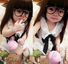 Haha way to cute!! This asian baby girl s so cute with her glasses