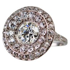 Diamond Disc Ring | From a unique collection of vintage cluster rings at https://www.1stdibs.com/jewelry/rings/cluster-rings/