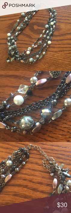 Multiple Strand One Clasp Necklace Beautiful decorative necklace, adjustable sizing, multiple strands on one fastener. Soft mauve, blue, gray, white and black throughout the necklace with a dark chain. Excellent condition. Great piece to dress up any outfit. Lia Sophia Jewelry Necklaces