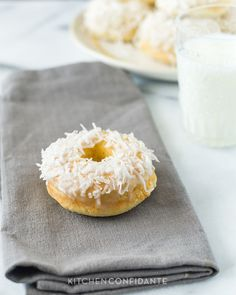 This is a recipe for baked coconut doughnuts with a coconut glaze and topping.