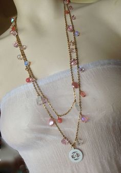 Lengthwise view of the Vintage Chanel charm on beaded vintage necklace.  One available!