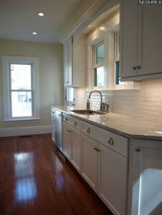 I like the windows over the sink and the subway tile back splash.
