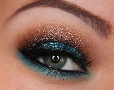 This is a very daring look! Bad to the bronze color tattoo on the top and then a dark navy on the bottom gorgeous!