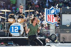 Drummer Matt Cameron (L) and singer Chris Cornell of Soundgarden perform on stage during the NFL Kickoff concert presented by Xbox before the Seattle Seahawks play the Green Bay Packers at CenturyLink Field on September 4, 2014 in Seattle, Washington.