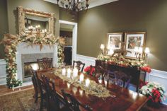 Homes for the Holidays: Cathye and Rick Amoses' dining room glows with twinkling candles among gold netting and gilded poinsettias and pinecones. Photo by Neil Ladner for Mississippi Magazine.