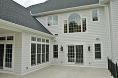 Beautiful custom Martin windows overlooking a patio off for outdoor entertaining and dining.