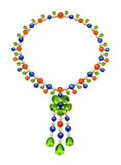 BULGARI Necklace from Bulgari's high jewelry collection in 18k yellow gold with peridots, sapphires, garnets and diamonds, price upon request; available at Bvlgari boutiques