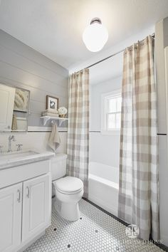 Kid's Bathroom by A Well Dressed Home, LLC. To read more about this project, please visit: http://awelldressedhome.com/3902-our-farmhouse-renovation-reveal-part-4-the-twins-rooms-and-bathroom/