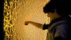 Firewall by Aaron Sherwood. An interactive media installation created in collaboration with Mike Allison. A stretched sheet of spandex acts as a membrane interface sensitive to depth that people can push into and create fire-like visuals and expressively play music. More information available at: http://aaron-sherwood.com/works/firewall Will be used in the performance piece Mizaru: http://www.purringt.com/mizaru