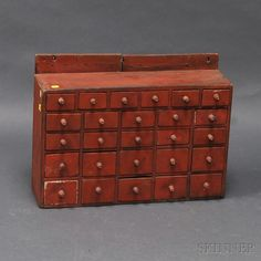 Small Red-painted Hanging Apothecary Cupboard, America, 19th century, ht. 16 3/4, wd. 22 3/4, dp. 6 1/2 in.