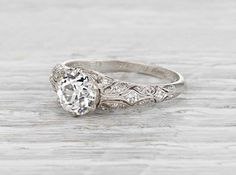 Antique Edwardian engagement ring made in platinum and set with a 1.05 carat GIA certified old European cut diamond with H color and VS2 clarity. Circa 1916. The ring represents the type of classic and beautifully designed vintage engagement rings we live for! This Edwardian stunner features intricate filigree accented with small diamonds and impeccable craftsmanship. Diamond and gold mining has caused devastation in areas such as Africa, wreaking havoc on delicate ecosystems and…