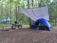 Tarp setup for tent camping in the rain. I highly recommend this method.