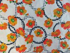Geometric floral 60s fabric. Feels cottony, but could be a blend. Has cool varied sized ridging incorporated into the fabric which creates