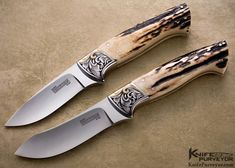 "Curt Erickson Custom Knives Pair of Julie Warenski Engraved Stag Drop Point Hunter and Skinner Knives.  Blade Length: 	3 1/4""  Overall Length: 	8""  Closed Length: 	N / A  Blade Steel: 	Mirror Polished ATS-34  Scale Material: 	Stag  Guard Material: 	Engraved Nickel Silver with 24Kt Gold Inlays"