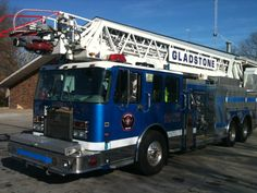 Gladstone Fire Department (MO) Aerial Apparatus in an usual color for a fire truck.  www.SetcomCorp.com