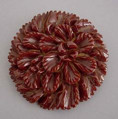 Deeply carved chocolate bakelite  brooch.....love the carved florals!