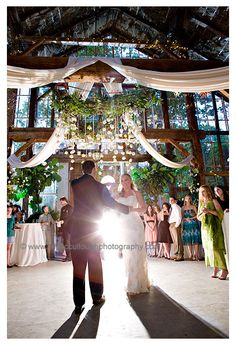 A large hanging wreath with hanging ivory roses