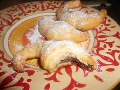 """""""easy Nutella croissants""""...yep, we're using prepackaged crescent rolls, but I have to admit they look really good!  (and they ARE really GOOD)"""