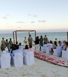 Beach wedding in Puerto Morelos, Mexico. Love that the bride and groom faced toward their guests to exchange vows!