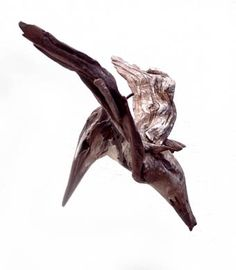 A pied Kingfisher hovering, minimal driftwood sculpture by Tony Fredriksson www.openskywoodart.com