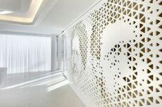 Perforated_walls_with_portraits-Modern Bank Interior Design - Raiffeisen in Zurich