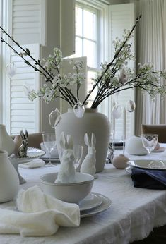 When styling your Easter table, a centrepiece can create a real wow factor. This textured cream vase has been filled with a few stems of our faux Gypsophilia and faux pussy willow and then finished off with our decorative eggs. Clearly we would remove it whilst eating but as your guests walk in to the room they are sure to be impressed with this look! fabulous table styling with little effort. #eastertable #tablestyling #eastertablescape