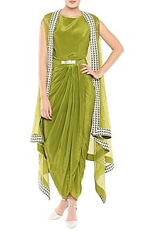 Featuring an olive green draped dress in crepe base with metal belt. It is paired with matching cape jacket in net base with hand embroidery. FIT: Fitted at bust. CARE: Dry clean only. Indian Fashion Dresses, Indian Gowns Dresses, Dress Indian Style, Designer Party Wear Dresses, Kurti Designs Party Wear, Indian Fashion Designers, Indian Designer Outfits, Stylish Sarees, Stylish Dresses
