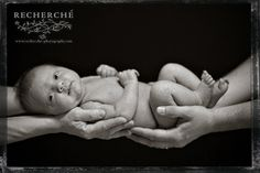 Baby Photography Ideas | Black and white portrait of a newborn baby girl cupped in both mother ...