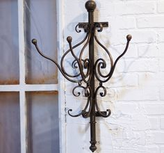 Our elegant iron wall coat rack will add a touch of class to your mudroom or foyer. For more wall mounted coat racks visit Antique Farmhouse. Coat Rack Bench, Diy Coat Rack, Wall Mounted Coat Rack, Coat Racks, Vintage Coat Rack, Coat Tree, Dark Home Decor, Wood Bead Chandelier, Whitewash Wood