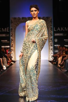 """Satya Paul """"The beauty of Saree lies in the subtle shading of threadwork and gold sparkle embellishment. A translucent net base offsets the colors and technique of the Saree."""""""